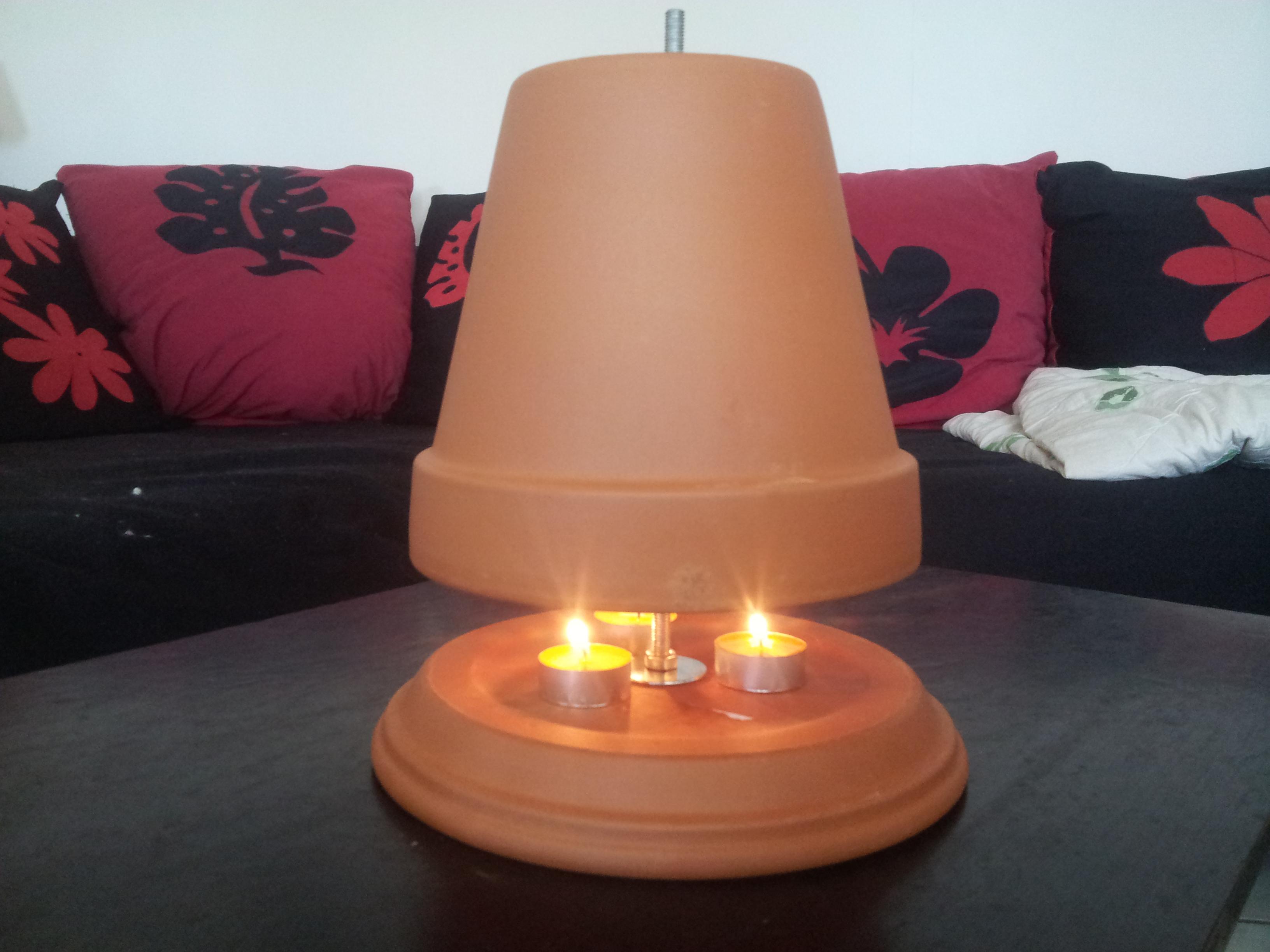 chauffage r alis avec des pot en terre cuite gratuit. Black Bedroom Furniture Sets. Home Design Ideas